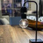 Designers have created a beautiful lamp with a light floating in the air.