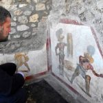 An ancient painting with bloody gladiators found in Pompeii